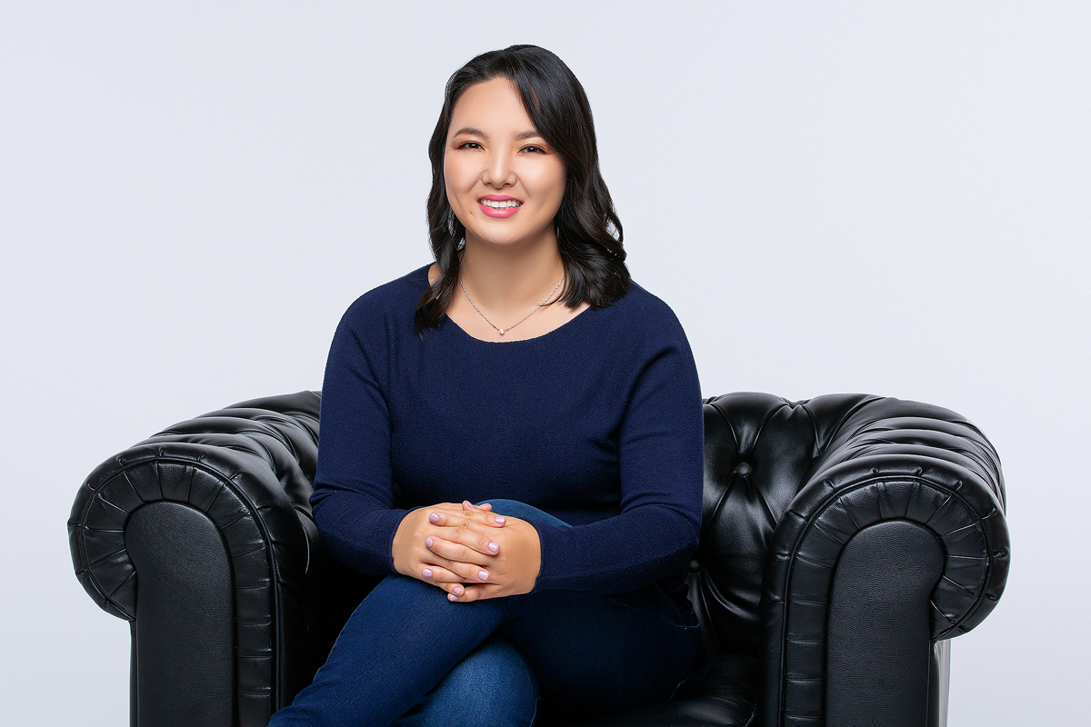 A Lady Sitting on a Black Couch