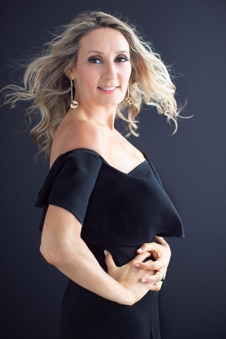 A Creative Shot of a Woman in Black Off-Shoulders Dress