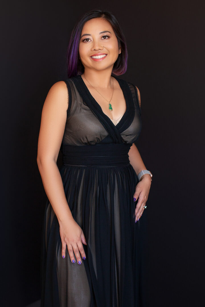 A Lady in Black Sleeveless, See-Through Long Dress